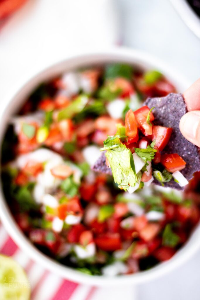 This is the best homemade pico de gallo made with fresh roma tomatoes, white onion, cilantro, and lime juice. It is so much better than store-bought.