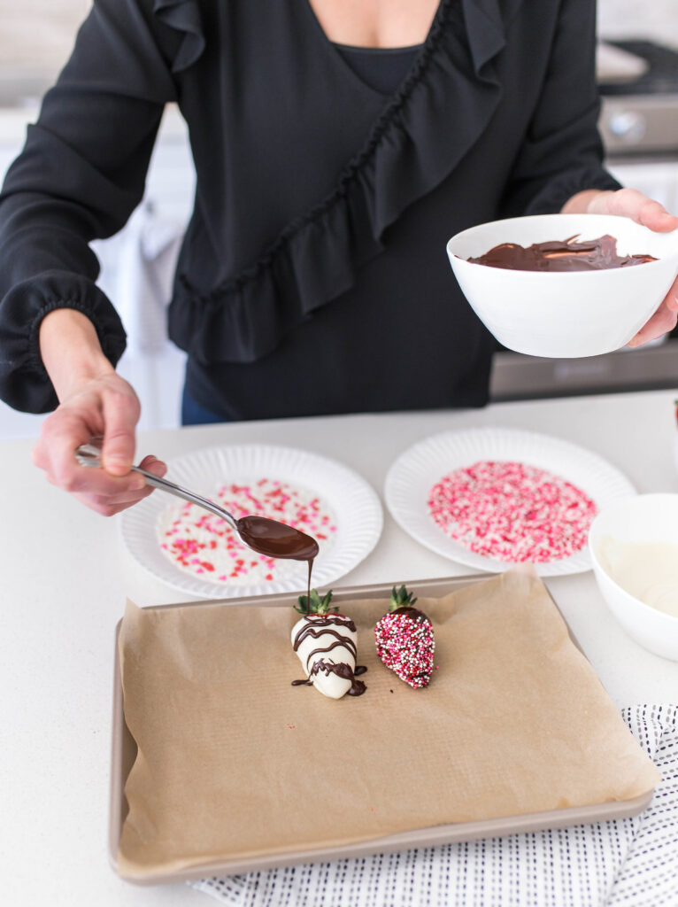 A festive favorite for any celebration, these easy chocolate covered strawberries are sure to be a hit!  #athousandcrumbs #chocolatecoveredstrawberries #strawberries #easydessert #dessertideas