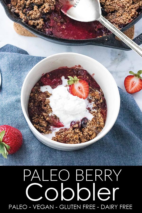 Paleo Berry Cobbler from A Thousand Crumbs A perfectly sweet paleo berry cobbler made with three kinds of berries and #autumnsgold paleo granola in the topping. Add coconut whipped cream for the ultimate #paleo treat. #athousandcrumbs #paleo #berry #cobbler #strawberry #blueberry #raspberry #coconutwhippedcream