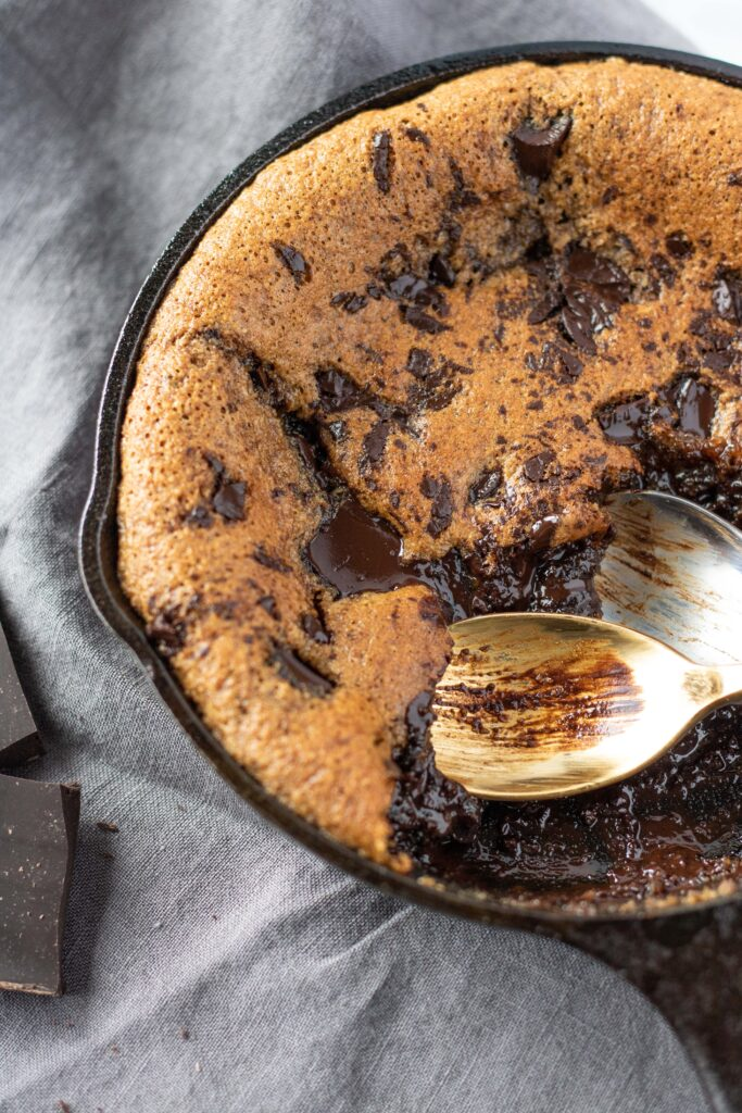 A decadent treat for two, you would never know this skillet cookie is paleo! #athousandcrumbs #glutenfree #skilletcookie #paleo #dairyfree #refinedsugarfree