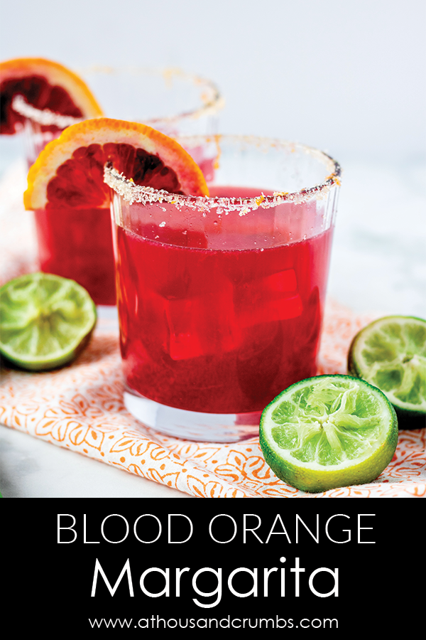 The perfect blood orange margarita recipe. This recipe has no added sugar, and is made with four simple ingredients #athousandcrumbs #margarita #bloodorange #cocktailrecipe #noaddedsugar