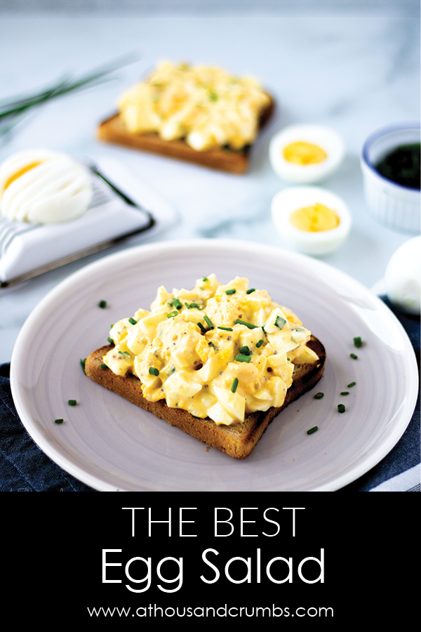 The best egg salad ever! It's lightened up thanks to the use of Greek yogurt, and seasoned to perfection. #athousandcrumbs #eggsalad #hardboiledeggs #lunchrecipe #easyrecipe #lightenedup #recipe