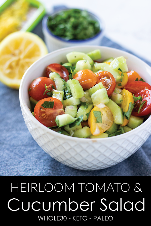 An easy and fresh side salad using ripe mini heirloom tomatoes and crisp cucumbers in a bright citrus dressing. The perfect Spring or Summer side dish. #athousandcrumbs #sidesalad #easyrecipe #tomato #cucumber #salad #paleo #whole30