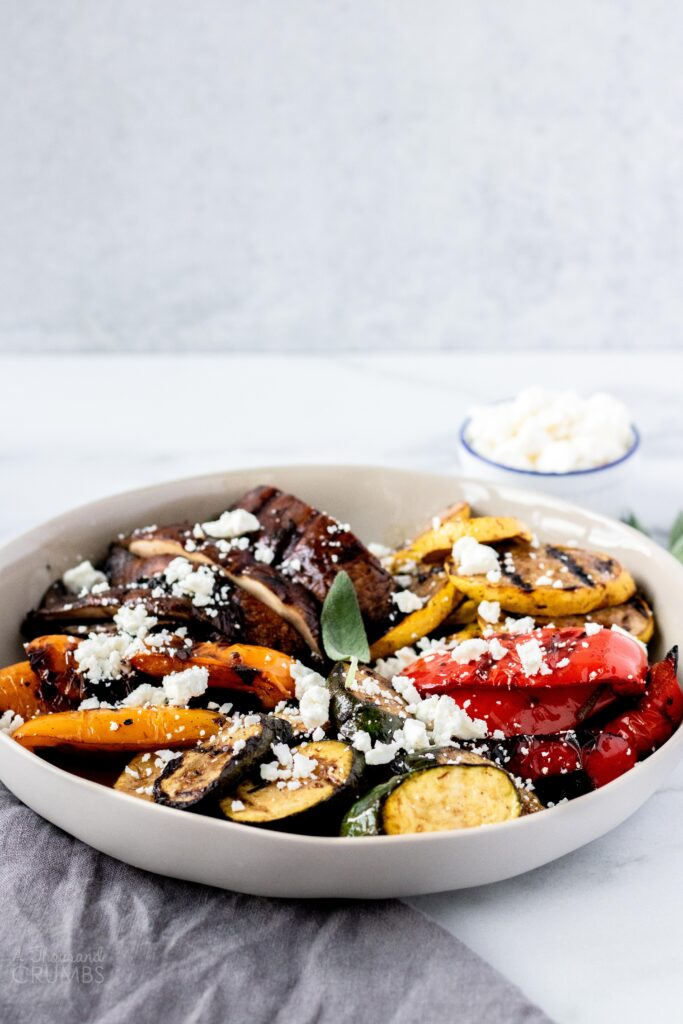 These easy grilled vegetables are the perfect Summer side dish.  The vegetables are marinated with balsamic, garlic, and fresh herbs before being grilled.  #easyrecipe #summer #recipe #grilling #vegetables #sidedish #vegetarian #whole30 #keto #paleo