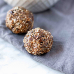Freezer-friendly and peanut-free protein bites are a delicious snack or dessert. They are full of healthy fats, heart healthy seeds, and sweetened with just a touch of honey. #athousandcrumbs #proteinbites #freezerfriendly #glutenfree #dairyfree #norefinedsugar #peanutfree